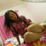 bed feet filipina full_body legs non-celebrity sitting