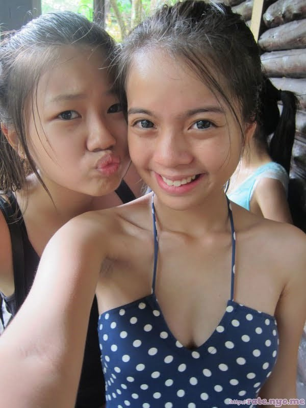 breasts malaysian non-celebrity one-piece smiling two_girls