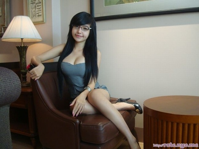 breasts cleavage dimples elly_tran_ha full_body glasses high_heels legs sitting thighs vietnamese
