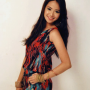 breasts filipina hand_on_waist non-celebrity sleeveless smiling