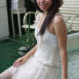 braces breasts dress hat legs malaysian non-celebrity shoulders sitting sleeveless smiling