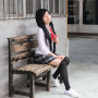 elly_tran_ha full_body legs rubber_shoes schoolgirl sitting skirt smiling socks thighs vietnamese