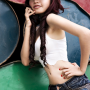 armpits breasts elly_tran_ha hand_on_waist hat midriff shorts shoulders standing vietnamese