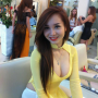 breasts cleavage non-celebrity sitting smiling vietnamese