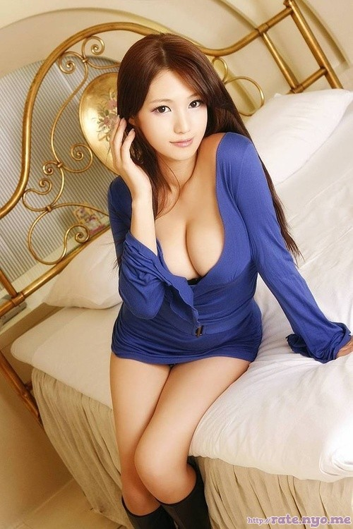 bed breasts chinese cleavage legs non-celebrity sitting thighs