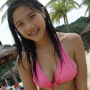 beach bikini braces breasts cleavage midriff non-celebrity shoulders singaporean smiling