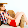 feet full_body japanese legs midriff pigtails pouting shorts shoulders sitting sleeveless thighs yuko_ogura