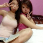 breasts chinese filipina legs non-celebrity peace_sign pouting shoulders sitting sleeveless two_girls