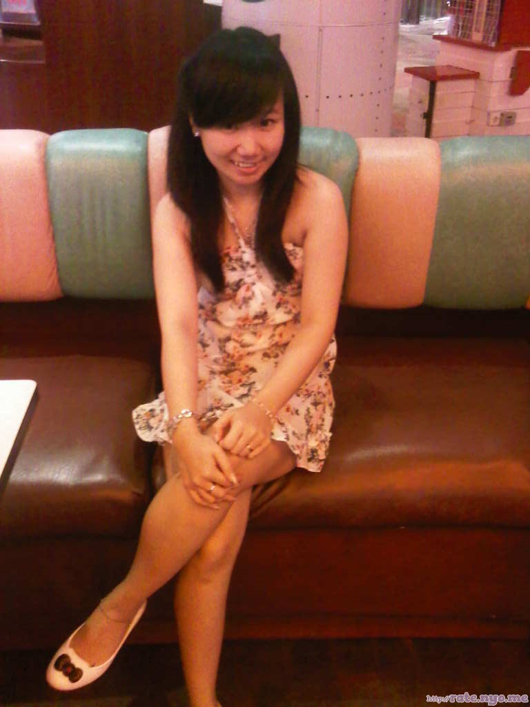dress indonesian legs non-celebrity shoulders sitting sleeveless smiling