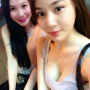 breasts cleavage non-celebrity selfshot shoulders sitting sleeveless smiling thighs two_girls vietnamese