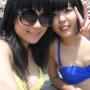 bikini breasts chinese cleavage midriff non-celebrity peace_sign pool selfshot smiling sunglasses tongue_out two_girls