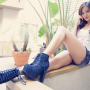 asian_american boots chinese full_body legs shorts shoulders sitting sleeveless thighs