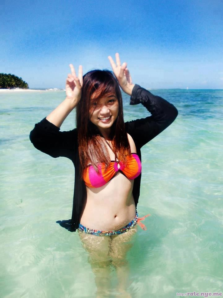 beach bikini breasts filipina midriff non-celebrity peace_sign smiling standing thighs wet