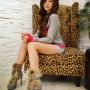 boots chinese full_body legs non-celebrity shorts sitting smiling thighs