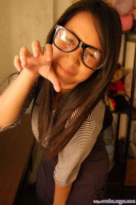 dimples filipina glasses leaning non-celebrity smiling