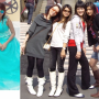 boots chinese dress four_girls full_body non-celebrity smiling standing sunglasses