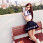 elly_tran_ha full_body glasses legs schoolgirl skirt smiling thighs vietnamese