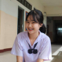 braces non-celebrity schoolgirl sitting skirt smiling thai