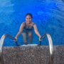 filipina legs non-celebrity one-piece pool shoulders smiling wet