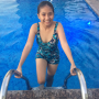 filipina legs non-celebrity one-piece pool shoulders smiling thighs wet