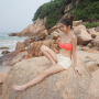 breasts cleavage feet full_body legs midriff non-celebrity shorts shoulders singaporean sitting thighs
