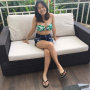 breasts cross-legged filipina full_body legs midriff non-celebrity shorts shoulders sitting smiling thighs