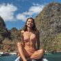 bikini breasts feet filipina full_body legs midriff non-celebrity shoulders sitting smiling thighs
