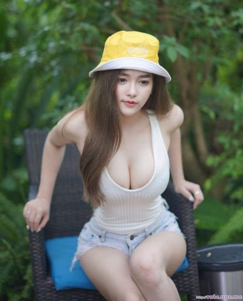 breasts cleavage hat leaning legs non-celebrity shorts shoulders sitting sleeveless thai thighs