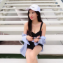 breasts cleavage legs shorts shoulders singaporean sitting